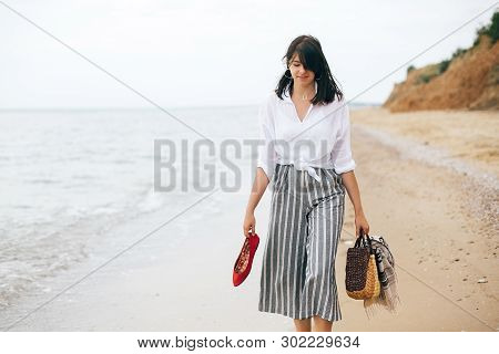 Happy Boho Woman Relaxing At Sea, Enjoying Walk On Tropical Island. Stylish Hipster Girl Walking Bar