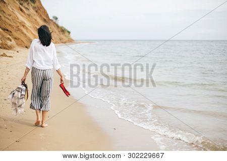 Happy Boho Woman Relaxing At Sea, Enjoying Walk On Tropical Island. Stylish Hipster Girl Walking Bar