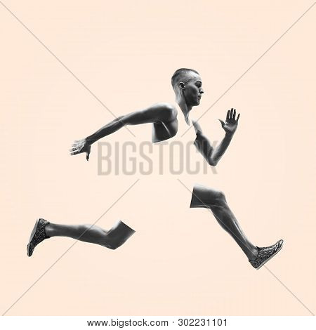 Young Caucasian Man Running Isolated On Studio Background. One Male Runner Or Jogger. Healthy Lifest