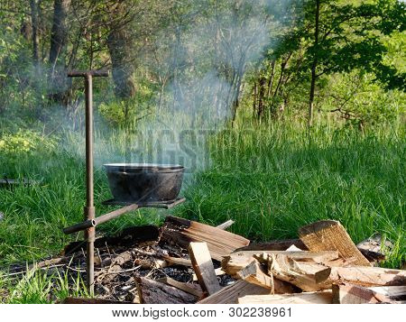 Pot On The Fire On A Green Background.