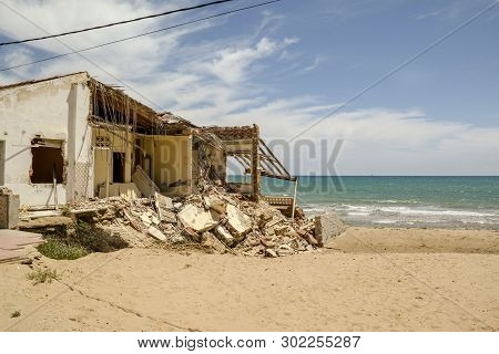 Guardamar, Alicante, Spain - May 20  2019 :  Damaged To Buildings Caused By Storms Of 2017