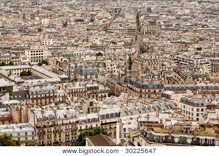 A Vast Sea Of Rooftops Across A Paris Cityscape