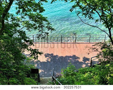Beautiful Summer Day On The Shore Of The Transparent Sea