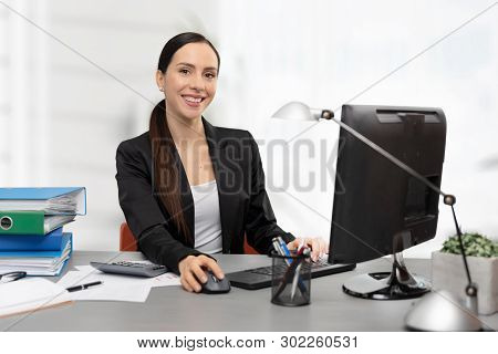 Business Woman Calculates Tax. Happy Accountant Working In Office