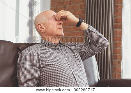 Older Man Has A Headache