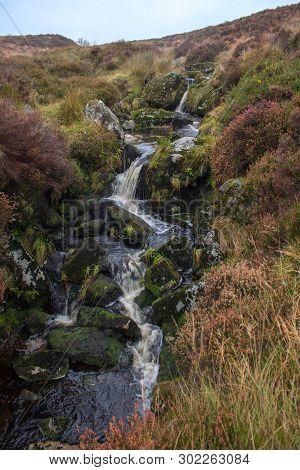 Stream Tumbling Through Heather In A Turf Bog