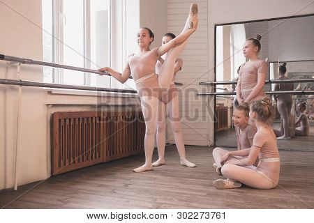 Young Graceful Female Ballet Dancers Dancing At Training Studio. Beauty Of Classic Ballet. Girls Per