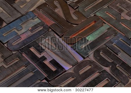 background of antique wooden letterpress printing blocks stained by color inks