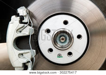 New Car Brakes. Car Brake System Closeup. Brake Support And Disk Close-up View.
