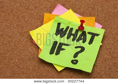 what if question - stack of color sticky notes on cork bulletin board