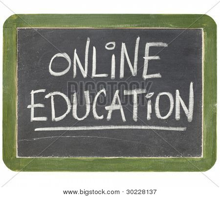 online education text  in white chalk handwriting on a vintage slate blackboard, isolated on white