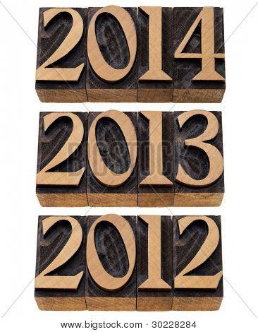 incoming years 2012, 2013, 2014 - isolated numbers in vintage wood printing blocks