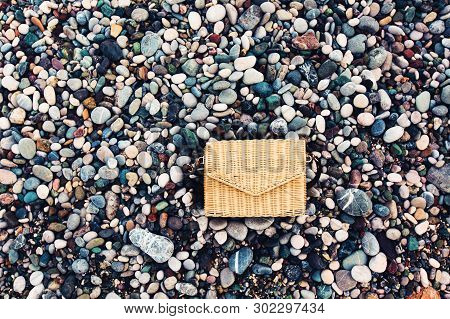 Stylish Straw Bag On The Beach. Trends Of Natural Materials, And Ecology On The Background Of Multic