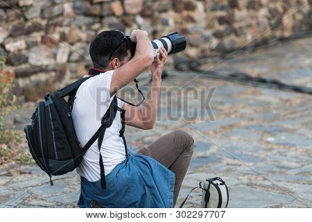 Caceres, Extremadura, Spain - May 20, 2019: Professional Photographer Taking Photographs During The