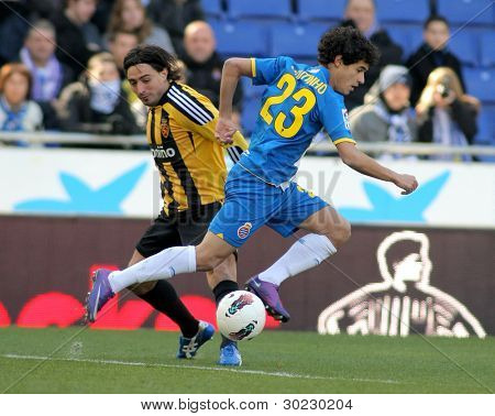 BARCELONA - FEB 12: Pablo Alvarez(L) of Real Zaragoza vies with Coutinho(R) of RCD Espanyol during a Spanish League match at the Estadi Cornella on February 12, 2012 in Barcelona, Spain