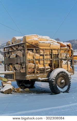 Cart, Trailer, Wagon For Transportation Of Firewood Is For Sale In The Countryside In The Snow In Wi