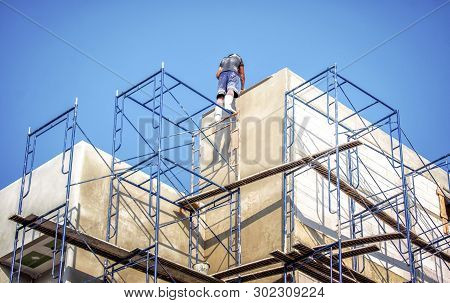 Apartment Building Being Constructed With No Safety Equipment For Workers