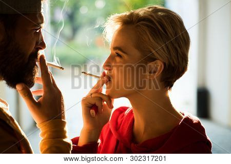 Couple Find Place For Smoking Cigarette In Tranquility. Enjoying Every Breath Of Smoke. Smoking Habi