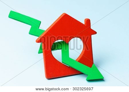 Arrow Down And House On Blue Background. Falling Market Price Of Real Estate.
