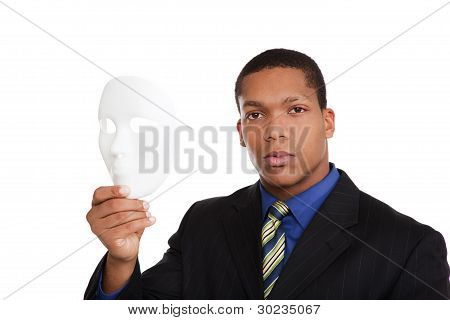 Businessman holding mask