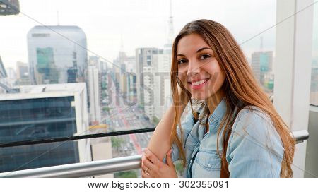 Attractive City Woman Over The Rooftops Of Sao Paulo With View To The Skyline And The Paulista Avenu