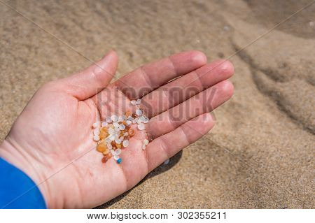 Woman Holding Small Tiny Harmful Plastic Beads Collected On The Beach In Zante, Zakynthos, Greece