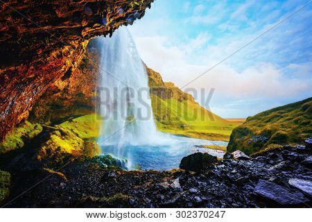 Gorgeous landscape from Seljalandfoss waterfall on Seljalandsa river, Iceland, Europe. View from inside