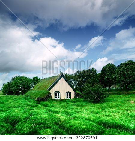 Traditional turf-top church in village Hof, Vatnajokull National Park, Iceland. Landscape photography