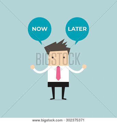 Businessman With Now Or Later Balloon Text. Businessman Select Choice Now Or Later.