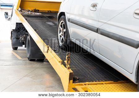Broken Down Car Towed Onto Flatbed Tow Truck With Hook Cable