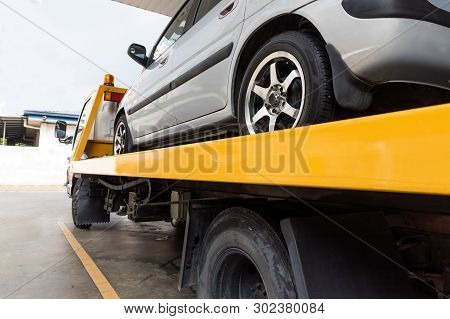 Broken Car On Flatbed Tow Truck Being Transported For Repair
