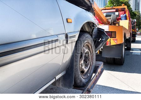 Tow Truck Towing A Broken Down Car In Emergency On The Street