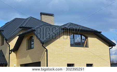 Valley And Gable New Modern House Ceramic Tiled Roofing Construction. Brick House With Problem Gable