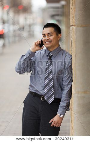 Hispanic Businessman - Leaning On Wall