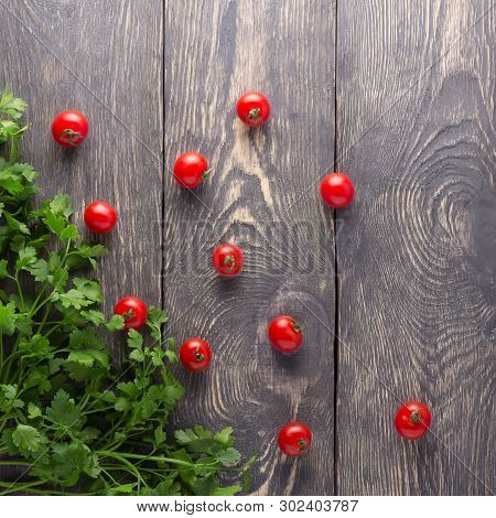 Top View. Fresh Tomatoes And Parsley On A Wooden Boards