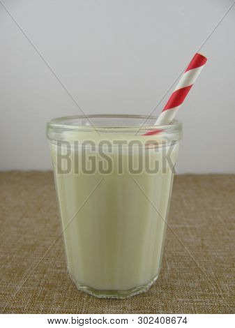 Fresh Homemade Buttermilk In A Glass With A Drinking Straw