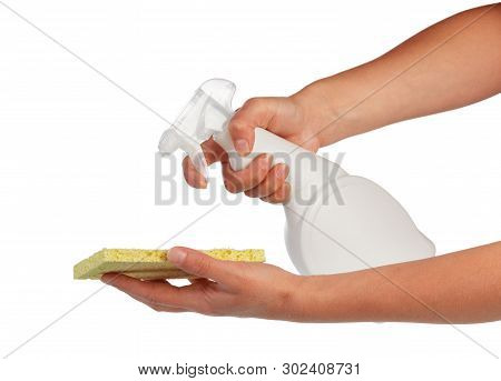 Female Hands Pouring Means For Cleaning The Yellow Sponge Isolated On White Background