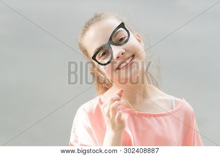 She Is Radiating Happiness. Small Smiling Girl With Funny Look Through Prop Glasses. Happy Little Ch