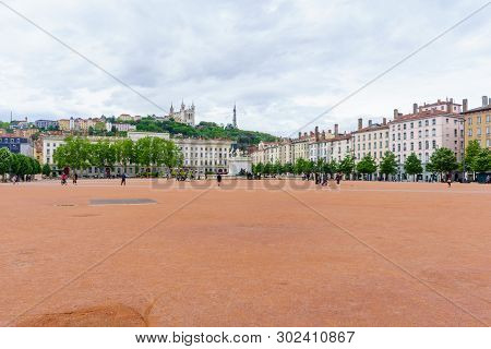 Lyon, France - May 08, 2019: Scene Of Place Bellecour Square, With Locals And Visitors, In Lyon, Fra
