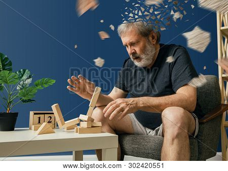 Drown Image Of Losing Of Mind. Old Bearded Man With Alzheimer Desease Has Problems With His Hands Mo