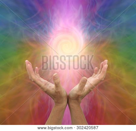 Channeling Rainbow Coloured  Vortex Healing Energy  - Female Hands Held Open And Palms Upwards With