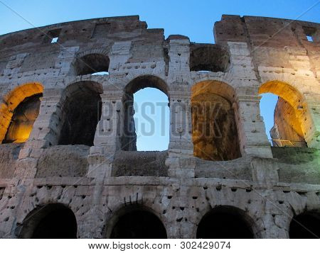 Fragment Of Colosseum Facade (flavian Amphitheatre) In Rome, Lazio, Italy. Colosseum Is Famous Landm