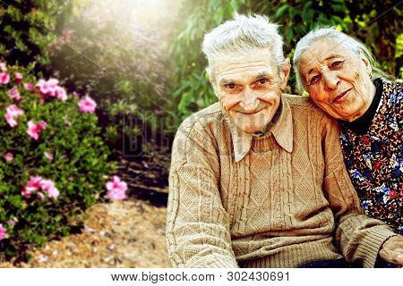Outdoors portrait of happy senior married couple