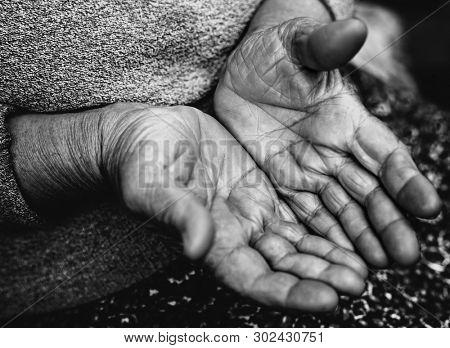 Poor old hands of homeless street beggar