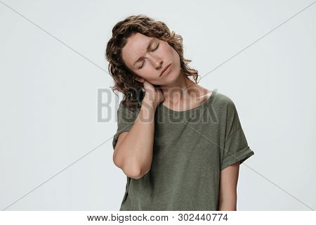 Tired Sad Young Woman Suffering From Fatigued Massaging Hurt Stiff Neck Rubbing Tensed Muscles To Re