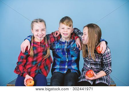 Eating Fruits And Vegetables Benefits Childrens Health. Cute Little Children Holding Red Apples. App