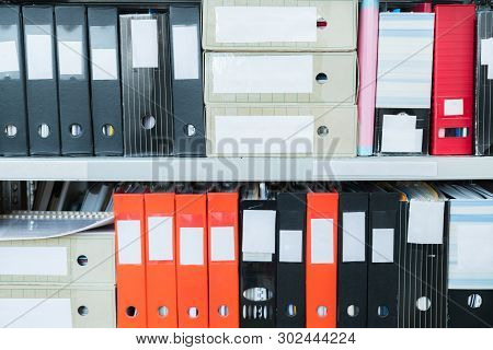 Colourful Blank Blind Folders With Files In The Shelf. Archival, Stacks Of Documents At The Office O