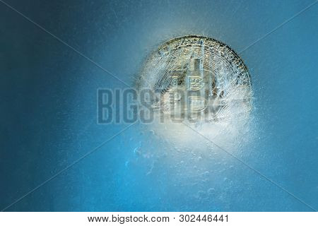 Silver Bitcoin, Bit Coin Online Digital Currency Frozen In The Blue Ice. Concept Of Block Chain, Cry