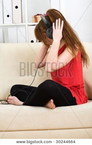 Beautiful Teenage Girl Listening To Music