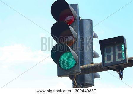 Glowing Green Traffic Light. Green Light On A Street Light. One Second Remains To Turn Yellow And Re
